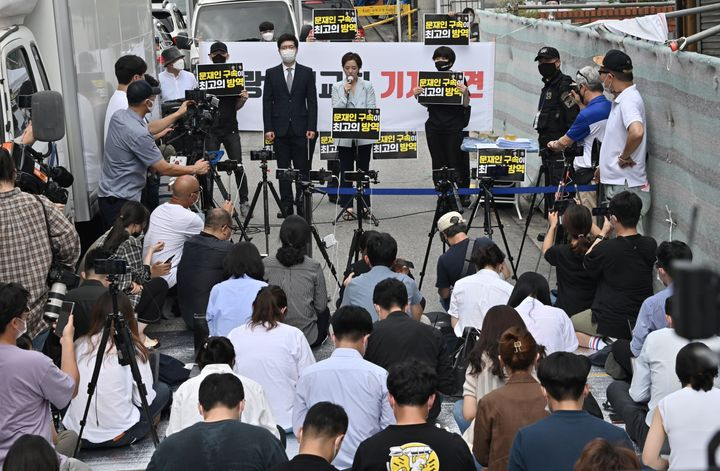 A lawyer for Sarang Jeil Church holds a press conference near the church in Seoul on August 17, 2020.