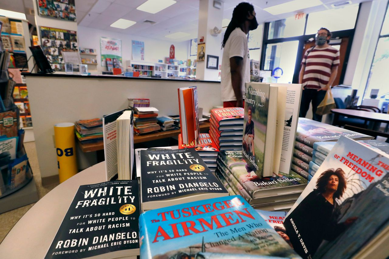 """Books including """"The Tuskegee Airmen"""" and """"White Fragility"""" on display in June at the Black-owned Frugal Bookstore in Boston. """"White Fragility"""" has sat near or at the top of the New York Times bestseller list as Black Lives Matter protests have swelled."""