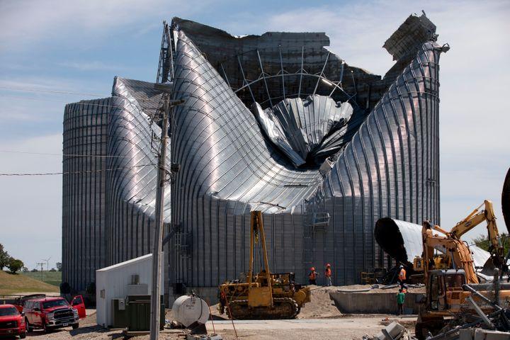 Grain bins at the Heartland Co-Op grain elevator in Malcom, Iowa, were damaged by a powerful storm that swept through Iowa on Aug. 10.