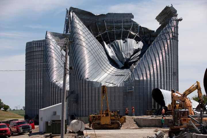 Grain bins at the Heartland Co-Op grain elevator in Malcom, Iowa, were damaged by a powerful storm that swept through Io