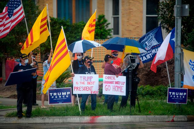 Protesters hold up signs and flags outside of the Chinese consulate in Houston, Texas, on July 24, 2020,...