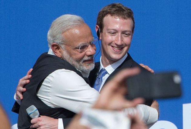 Prime Minister Narendra Modi and Facebook CEO Mark Zuckerberg hug after a Townhall meeting, at Facebook...