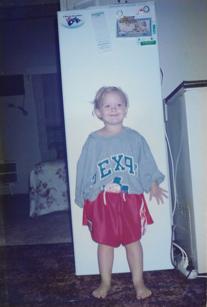 Me in my older brother's football gear at age three.