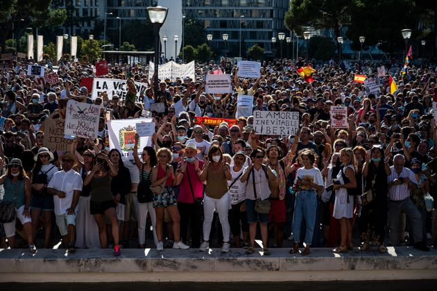 Protesters in Madrid rally against the mandatory use of face masks and other measures adopted by the...