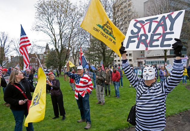 In the United States, protesters rally against lockdown restrictions outside of the capitol building...