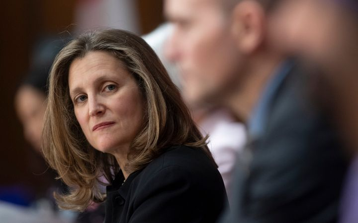 Deputy Prime Minister Chrystia Freeland listens to a speaker during a news conference in Ottawa on April 7, 2020.