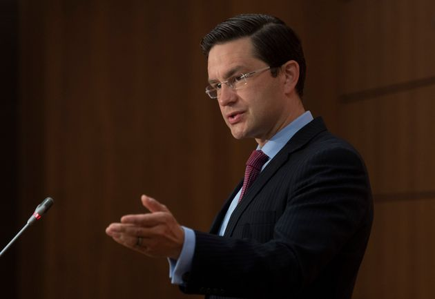 Conservative MP Pierre Poilievre speaks about the resignation of the finance minister during a news conference...