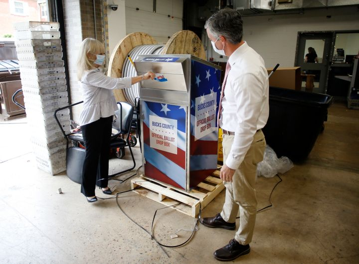 In this May 27, 2020, file photo, Bucks County commissioners Diane Ellis-Marseglia, left, and Robert Harvie unpack a new ball