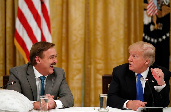 """Lindell sits next to Trump during a """"Made in America"""" roundtable event at the White House in 2017. He met with Trump again in"""