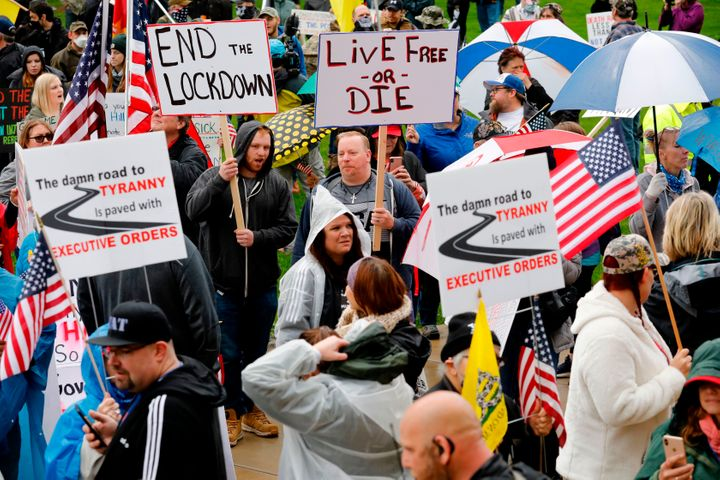 Demonstrators protest coronavirus-related health guidelines outside the Michigan Capitol on April 30, 2020, without wearing masks or social distancing.