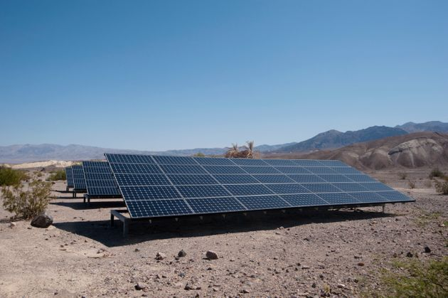 Surrounded by desert, the Photovoltaic Panels behind the National Park Service Furnace Creek Visitor...