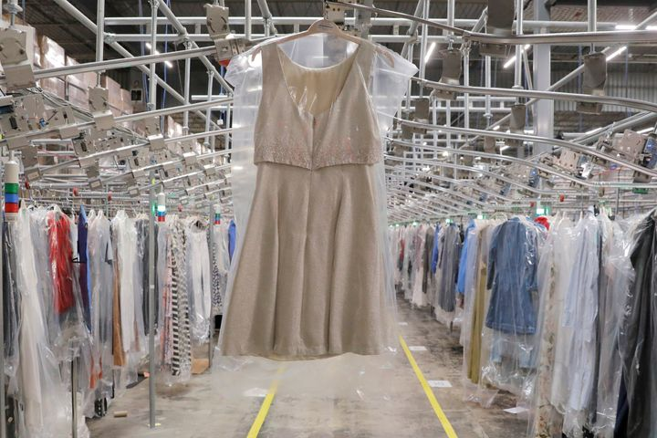 "A garment hangs in the automated sortation section at Rent the Runway's ""Dream Fulfillment Center"" in Secaucus, NJ in September 2019."