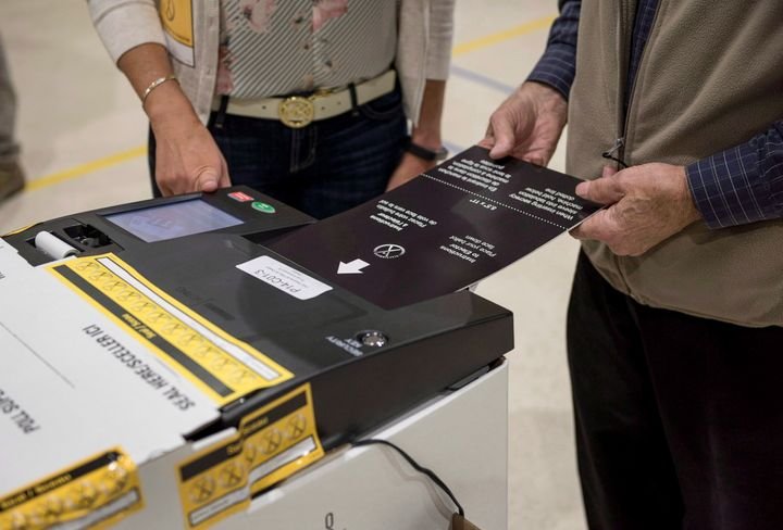A voter uses an electronic voting machine to cast their ballot in the New Brunswick provincial election at a voting station in Dieppe, N.B., on Sept. 24, 2018.