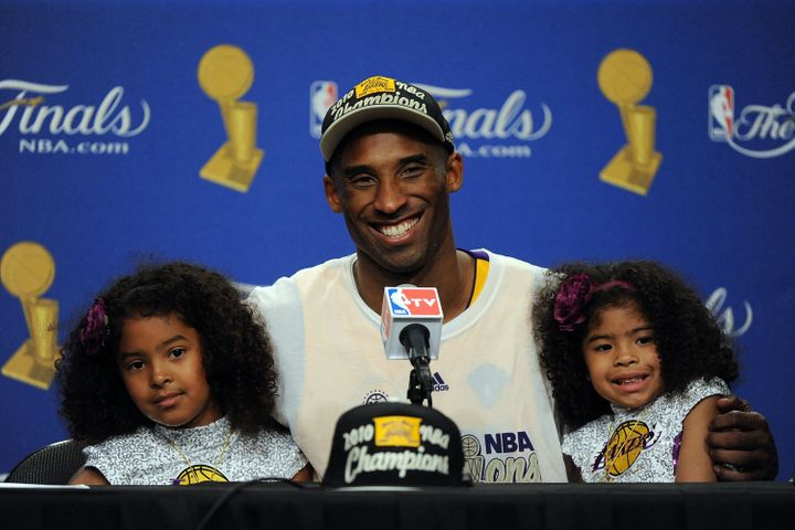 Kobe Bryant speaks during the post-game news conference with daughters Natalia and Gianna after the Los Angeles Lakers defeated the Boston Celtics in Game 7 of the 2010 NBA Finals.