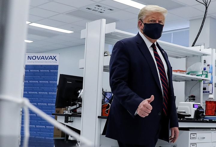 U.S. President Donald Trump tours a pharmaceutical manufacturing plant in North Carolina, where components for a potential coronavirus vaccine are being developed, on July 27.