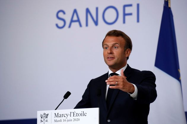 French President Emmanuel Macron delivers a speech after visiting the Sanofi pharmaceutical plant near...