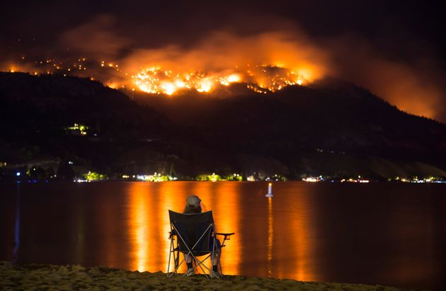 Flames are seen Wednesday from the Christie Mountain wildfire near Penticton,
