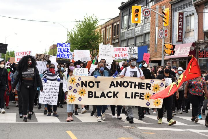 Protesters in Toronto march during a rally to protest racism and police brutality on May 30, 2020.