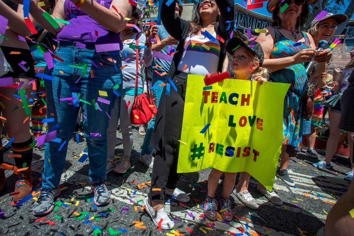 A young child holds a sign during the annual LA Pride Parade in West Hollywood on June 9, 2019.