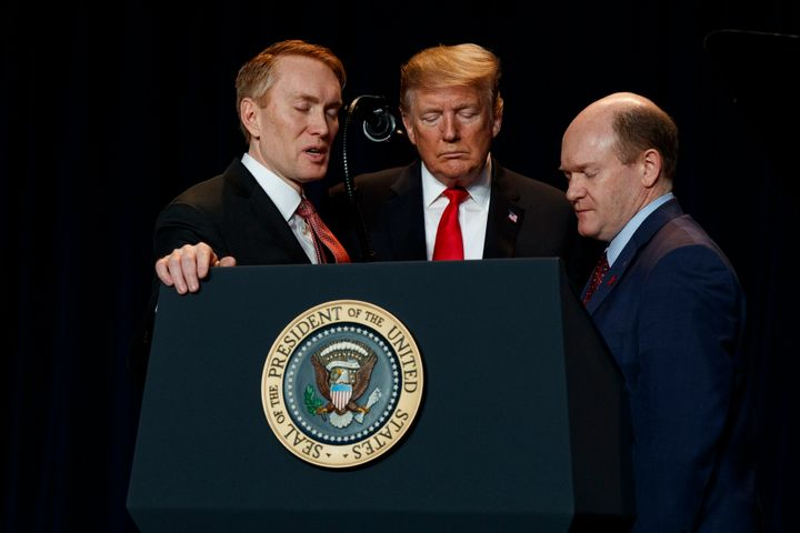 In this Feb. 7, 2019, file photo, Rep. James Lankford, left, (R-Okla.), President Donald Trump, and Sen. Chris Coons, (D-Del.