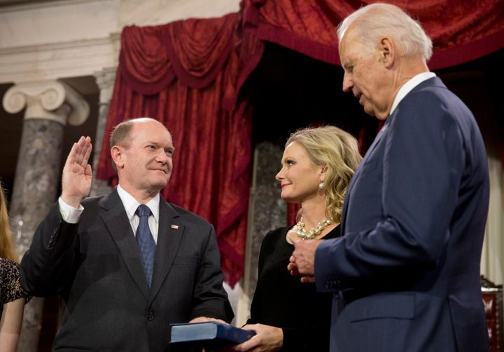 In this Jan. 6, 2015, file photo, Vice President Joe Biden administers the Senate oath to Sen. Chris Coons in the Old Senate