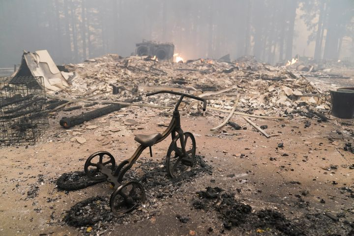 A charred tricycle was about all that was left standing Thursday inside a burnt-to-the-ground home in Bonny Doon, California.