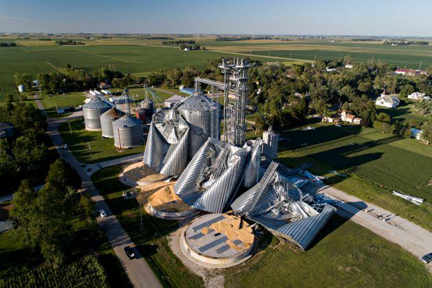 Damaged grain bins are shown at the Heartland Co-Op grain elevator on Aug. 11, in Luther, Iowa, after...