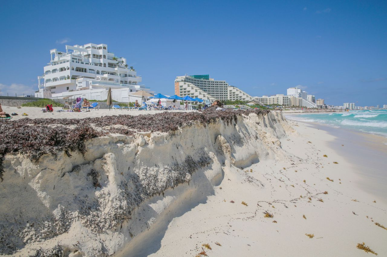 Hotel owners in Cancún and other tourist spots pay to repair beach erosion caused by waves and storms, sometimes trucking in replacement sand.
