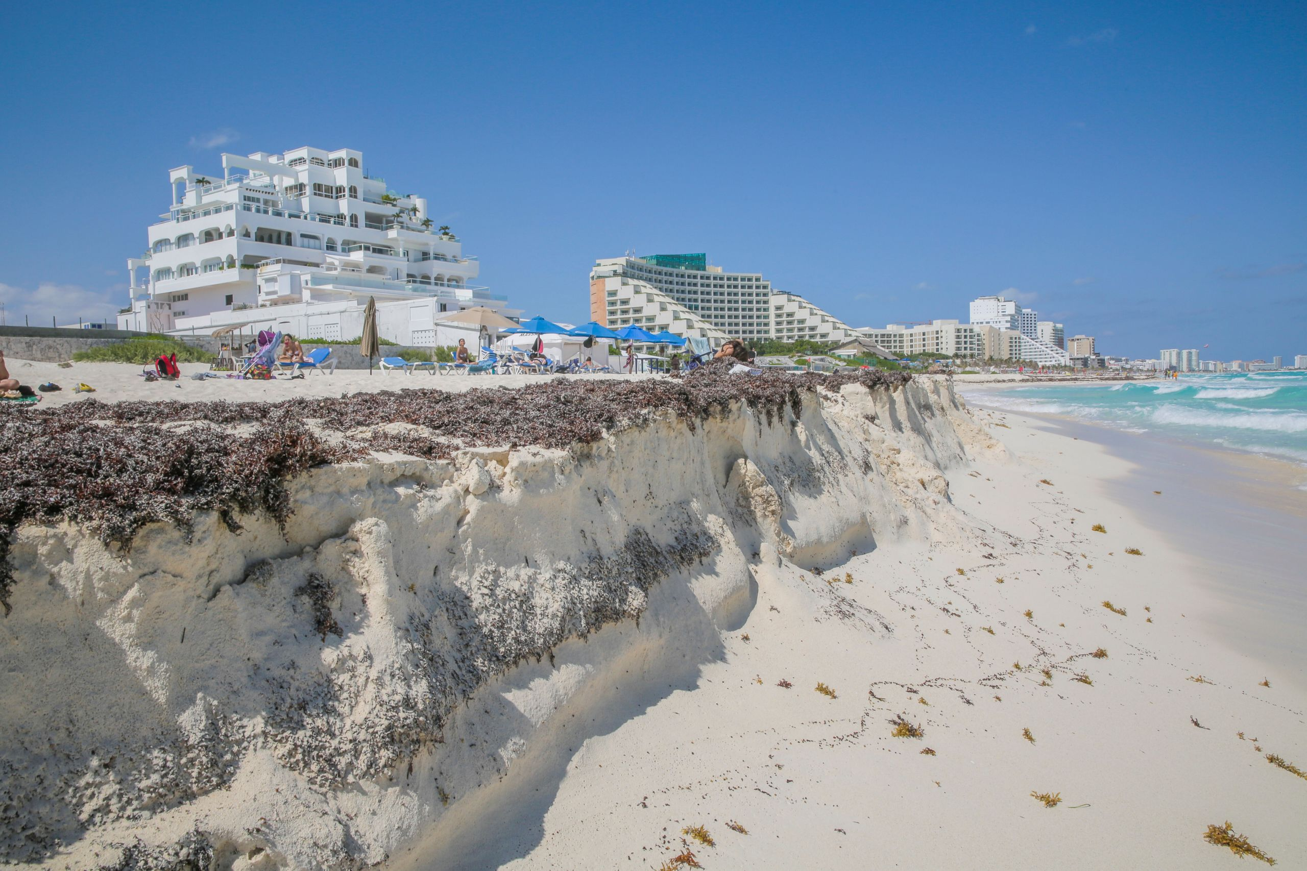 Hotel owners in Cancún and other tourist spots pay to repair beach erosion caused by waves and storms, sometimes truck