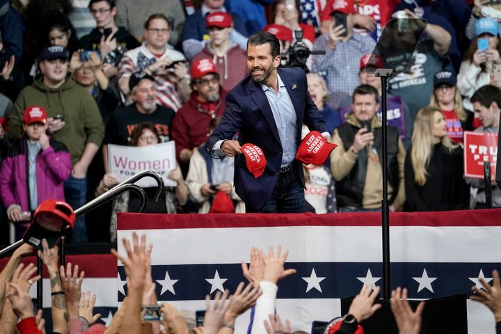 Donald Trump Jr. tosses hats into the crowd during a rally at Southern New Hampshire University Arena on Feb. 10 in Mancheste