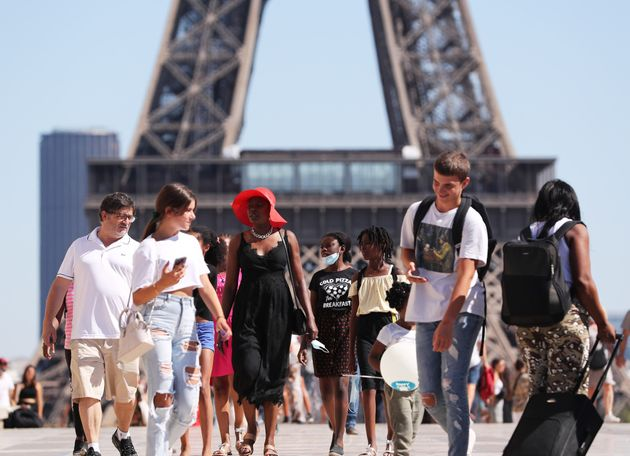 People enjoy the summer weather in Paris, France, on August
