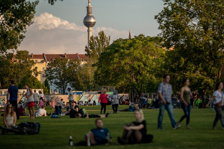 Visitors enjoy warm weather in Mauerpark in Berlin on July 25. On Thursday, Germany recorded its highest increase in coronavi