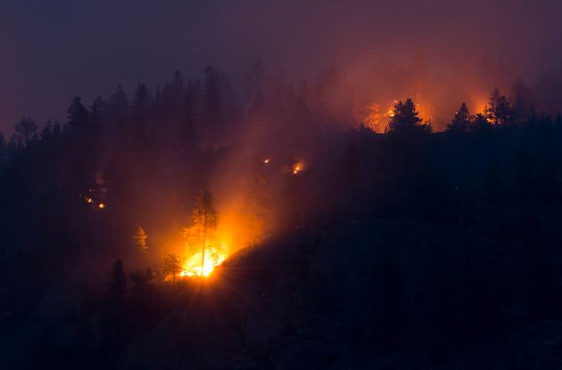 Flames are seen from the Christie Mountain wildfire Thursday in Penticton,
