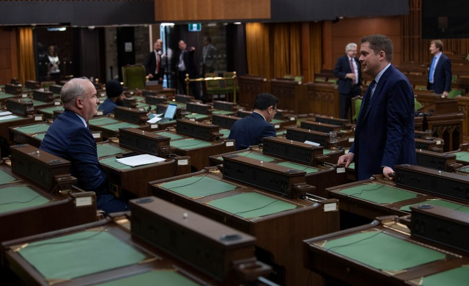 Conservative leader Andrew Scheer speaks with Conservative MP Erin O'Toole as they wait for the COVID-19...