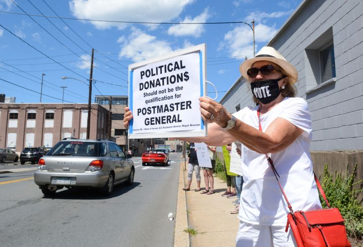 Protestors have targeted Postmaster General Louis DeJoy's political contributions to President Donald Trump.