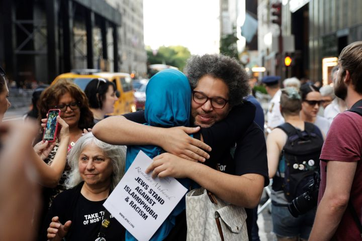 Activist Linda Sarsour hugs a friend as she prepares for the beginning of a demonstration and Iftar celebration during Ramada