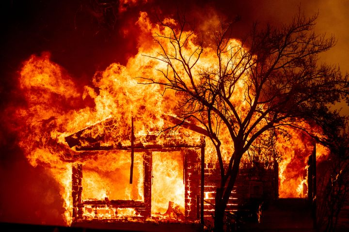 A home is destroyed Wednesday in Vacaville, California. Fire crews across the region scrambled to contain dozens of wildfires sparked by lightning strikes as a statewide heat wave continues.