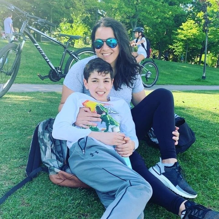 Nada Mokhtar Forbes, who's been dealing with lingering effects of COVID-19 since March, is pictured with her son.