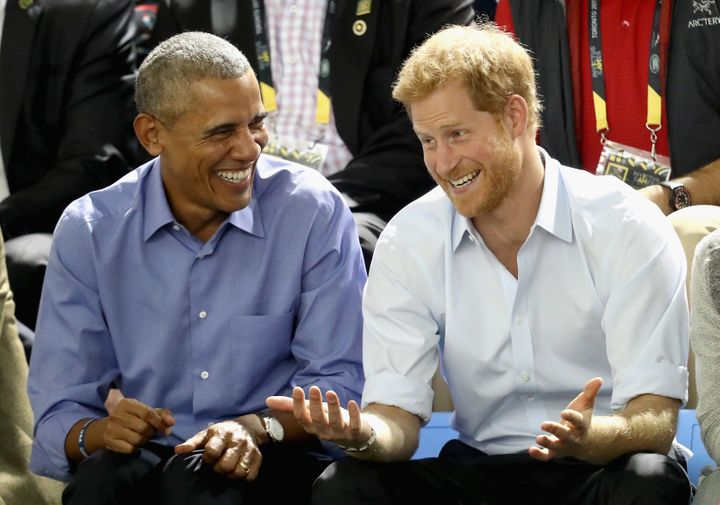 Former President Barack Obama and Prince Harry share a joke at the Invictus Games in 2017.