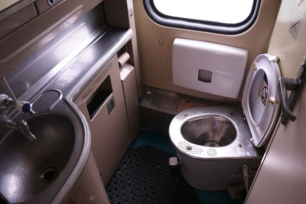The interior of the toilet on the train. Details and