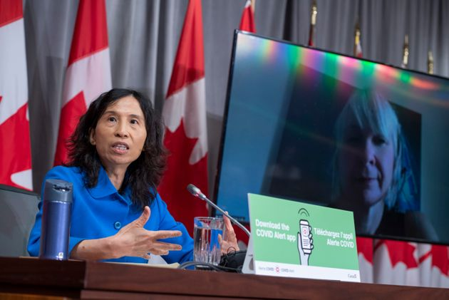 Minister of Health Patty Hajdu is seen on a videoconference display as Chief Public Health Officer Dr....