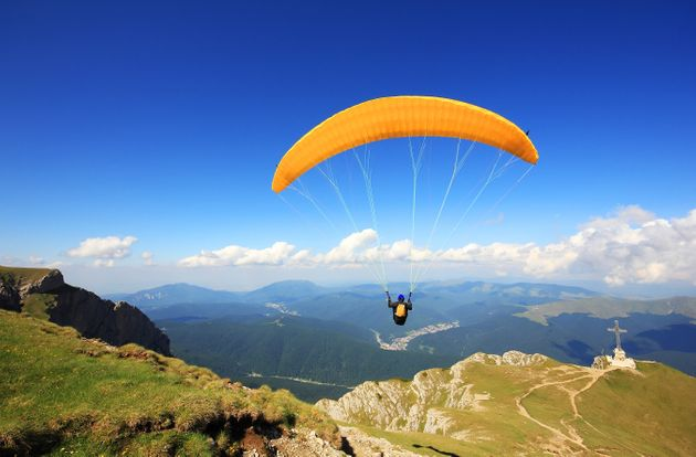 One Courageous Person Paragliding Over