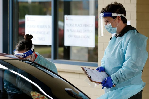 Medical professionals perform COVID testing at a drive through clinic on August 21, 2020 in Ballarat,