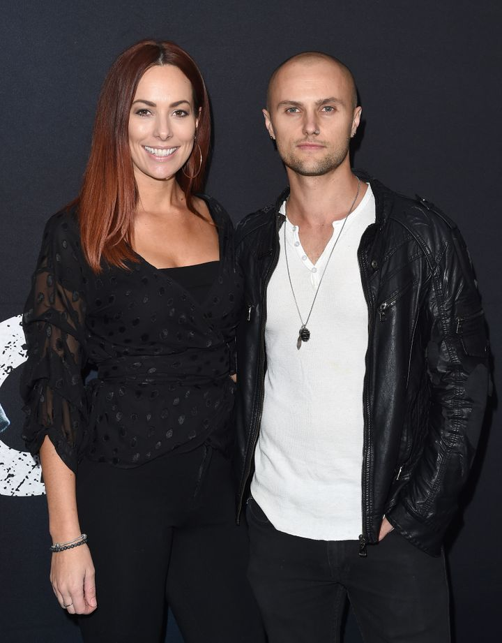 Actor Mark Furze (L) and Laural Barrett arrive at Universal Pictures' special screening of 'Breaking In' at ArcLight Cinemas on May 1, 2018 in Hollywood, California.