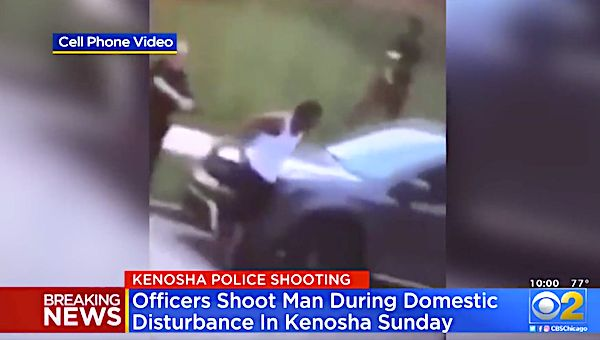 A video posted on social media showed Kenosha, Wisconsin police officers shoot at a man's back seven times as he leaned