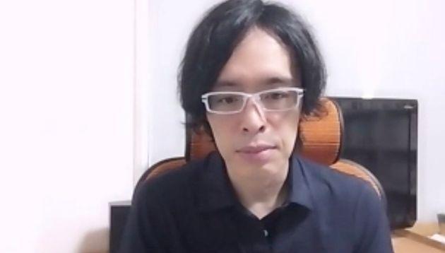 リモート取材に応じる明戸隆浩さん(法政大学特任研究員)