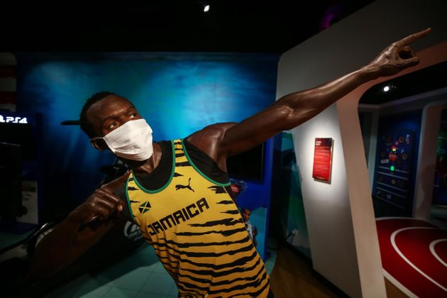 ISTANBUL, TURKEY - JULY 10: A wax sculpture of Usain Bolt is being displayed with a face mask to draw...