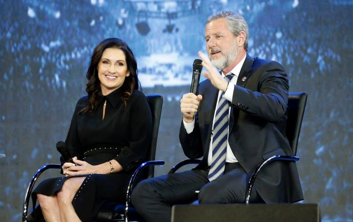 Jerry Falwell Jr., right, gestures as his wife, Becki listens during a town hall at Liberty University in Lynchburg, Va., Wed