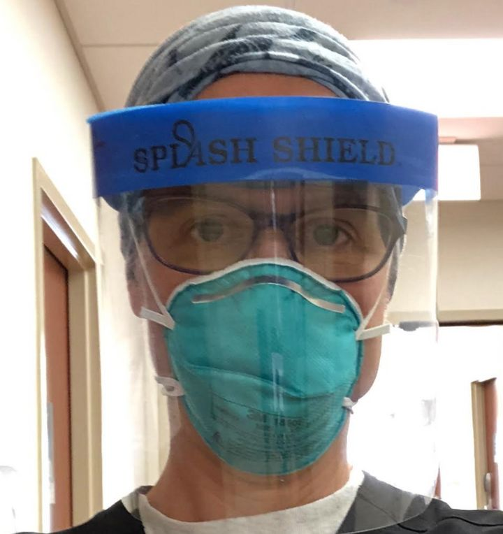 The author, shown wearing protective gear, returned to work in the emergency department of her hospital on July 3, 2020.