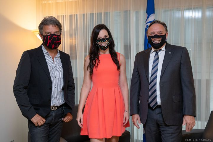 Designer Jean Airoldi, Rosalie Taillefer-Simard and Quebec's premier François Legault.